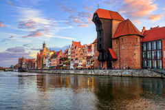 The Crane and gothic old town on sunset, Gdansk, Poland. The Zuraw Crane and colorful gothic facades of the old town in Gdansk, Poland, on sunset Royalty Free Stock Photos