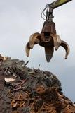 Crane grabber loading metal scrap royalty free stock photos