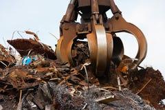 Crane grabber loading metal scrap stock photo