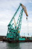 Crane in Harbor. Green Cargo Container Crane in Harbor Royalty Free Stock Photo