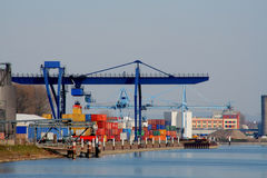 Crane in harbor. A crane by the work with cargo in a harbor Royalty Free Stock Images