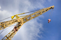 Crane in the harbor. Crane in the river harbor with dynamic clouds and blue sky in background Royalty Free Stock Photos