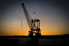 Crane at harbour Sydney. Crane at sunset in the harbour of sydney Stock Images