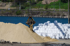 Crane head in river port. Heavy cranes unloading sand for bussiness. Resources delivery Royalty Free Stock Photography