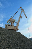 Crane at heap of gravel Royalty Free Stock Photos