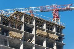 Crane and high-rise residential building. Real Estate Construction stock photography