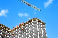 Crane and highrise construction site Stock Photos