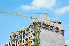 Crane and highrise construction site Stock Images