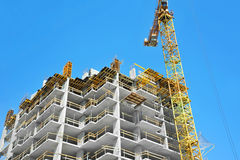 Crane and highrise construction site Royalty Free Stock Photo