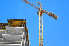 Crane and highrise construction site Royalty Free Stock Images