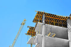 Crane and highrise construction site Stock Photography