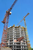 Crane and highrise construction site Royalty Free Stock Photography