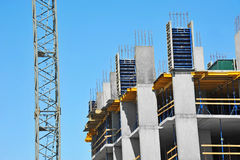 Crane and highrise construction site Royalty Free Stock Image