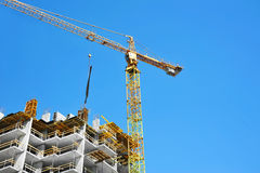 Crane and highrise construction site Stock Photos