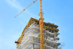 Crane and highrise construction site Stock Image