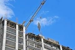 Crane hoisting formwork Royalty Free Stock Photo