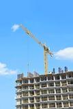 Crane hoisting formwork Stock Photography