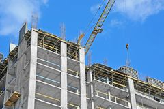 Crane hoisting formwork Royalty Free Stock Image
