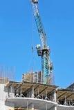 Crane hoisting formwork Royalty Free Stock Images