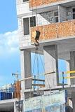 Crane hoisting formwork Stock Photo