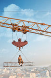 Crane holding construction builder eating. Royalty Free Stock Images