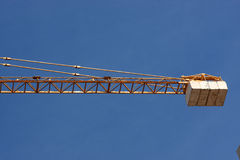 Crane holds load Royalty Free Stock Photo