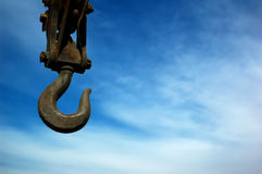 Crane Hook. On blue sky background Royalty Free Stock Photos