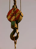 Crane hook. A detail of a crane hook lifting cargo Royalty Free Stock Images