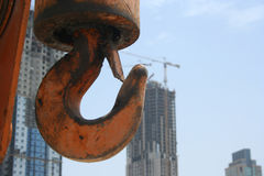 Crane Hook. A crane hook with skyscrapers in the background Stock Photography