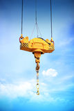 Crane Hook. On a blue sky Royalty Free Stock Photography
