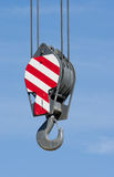 Crane hook against blue sky Royalty Free Stock Photo