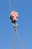 Crane hook against blue sky Stock Photo