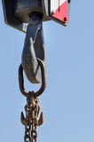 Crane hook against blue sky Royalty Free Stock Photo