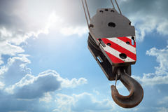 Crane hook on a blue sky Stock Photos