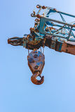 Crane hook on the blue sky Stock Images