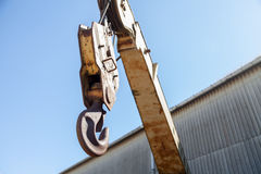 Crane hook on blue sky Royalty Free Stock Images