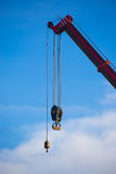 Crane hook on a blue sky. Crane hook ,Construction cranes working Stock Photography