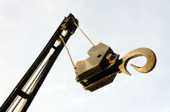 The crane hook. Bottom up view of a hanging crane hook at extreme closeup Stock Image