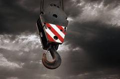 Crane hook on a dramatic sky background Stock Images