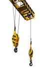 Crane hook hanging on steel ropes Stock Image