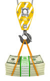 Crane hook holding stack of money Royalty Free Stock Images