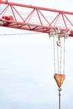 Crane hook. Hooked crane lifting something with copy space to the left Stock Photography