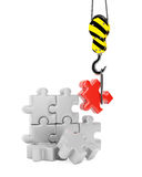 Crane hook and jigsaw puzzle Stock Images