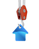 Crane hook lifting blue house icon  Stock Image