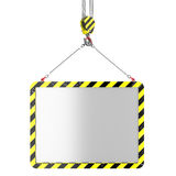 Crane hook lifting of placard Royalty Free Stock Images
