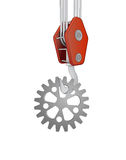 Crane hook lifting steel cogwheel  Royalty Free Stock Photo