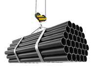 Crane hook lifting of steel pipes Royalty Free Stock Images