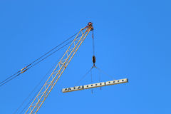 Crane hook with load and for building under construction Royalty Free Stock Photography