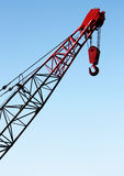 Crane Hook Portrait. Red crane hook against clear blue sky Stock Images