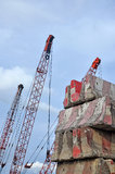 Crane hook and stack of concrete barriers Royalty Free Stock Photography